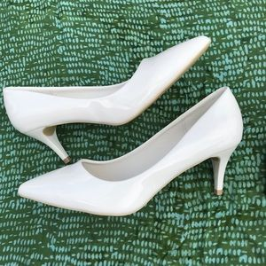 White patent pumps